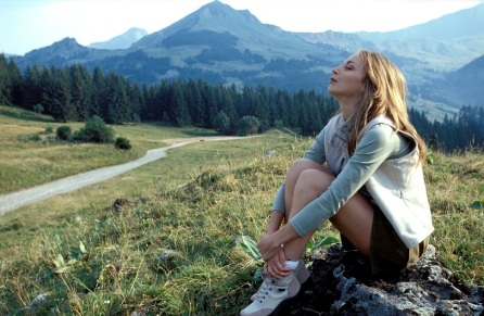 Woman sitting on mountainside